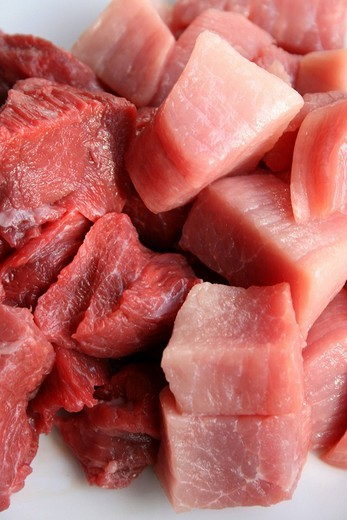Raw pork and beef, cut in squares for goulash : Stock Photo
