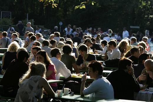 Munich, DEU, 05  Oct  2005 - People join the autumn sun at the famous beer garden namend Chinesischer Turm in Munich : Stock Photo