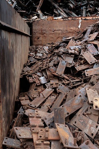 Pile of rusted iron parts in the scrapyard : Stock Photo