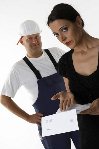 Woman is angry about the offer of a workman : Stock Photo