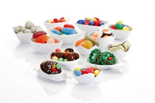 Stock Photo: 1848R-335076 Variety of candy easter eggs and sweets in porcelain bowl