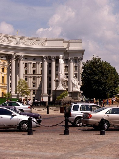 Ukraine Kiev Foreign Ministry 1939 at Michael place old building from Stalin column trees cars blue sky and clouds 2004 : Stock Photo
