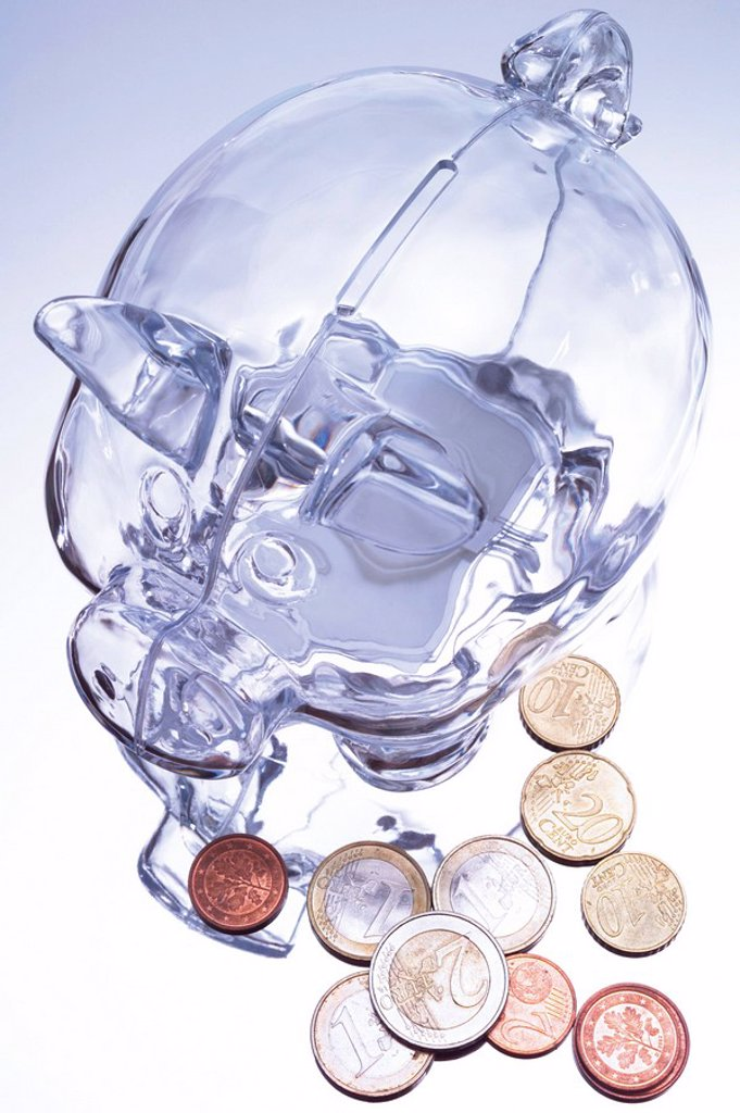 Glassy piggy bank with Euro coins : Stock Photo