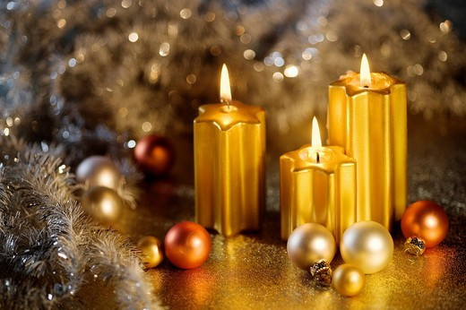 Burning golden candles with baubles for the Christmas tree : Stock Photo