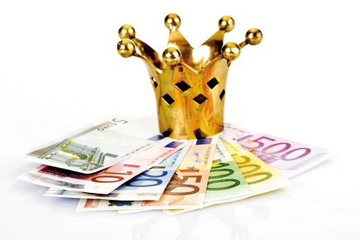 Golden crown on Euro notes : Stock Photo