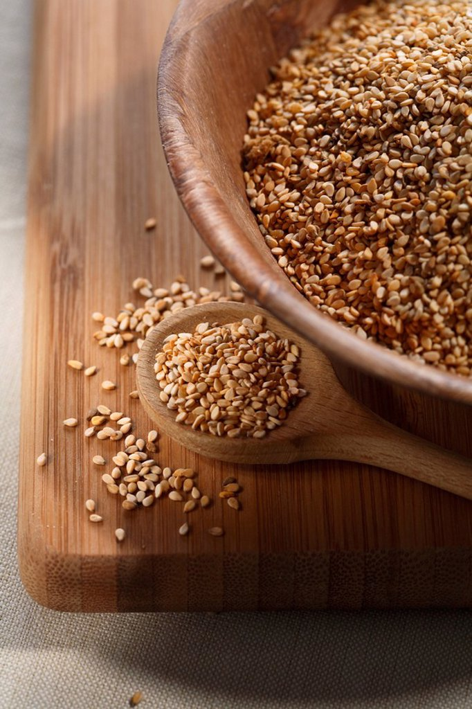 Linseeds, flax seed in a wooden bowl : Stock Photo