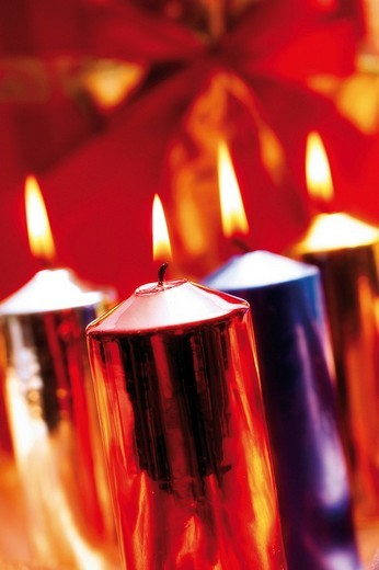 Stock Photo: 1848R-341210 Burning candles, lit candles, different metallic colours