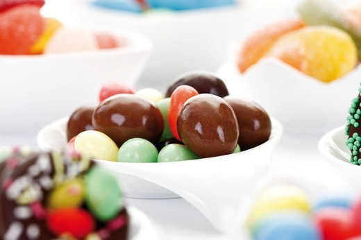 Variety of candy easter eggs and sweets in porcelain bowls : Stock Photo