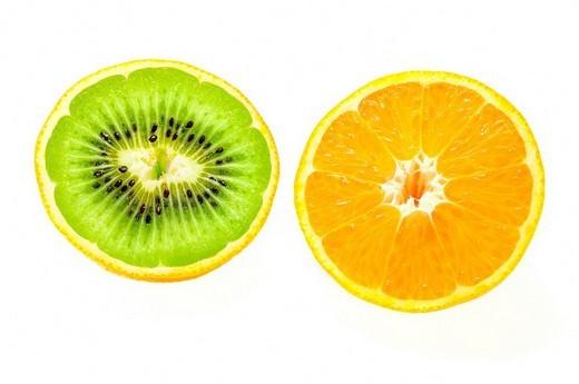 Orange filled with a Kiwi, symbolic image for genetic engineering : Stock Photo