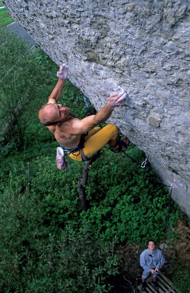 Sport climber climbing the extremely difficult route Primeur deluxe Germany : Stock Photo