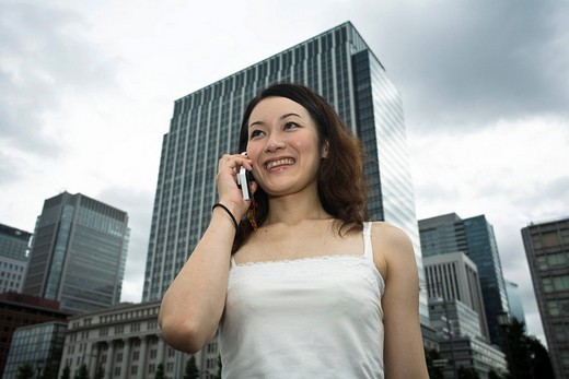 Stock Photo: 1848R-342413 Young woman with a mobile phone, Tokyo, Japan, Asia
