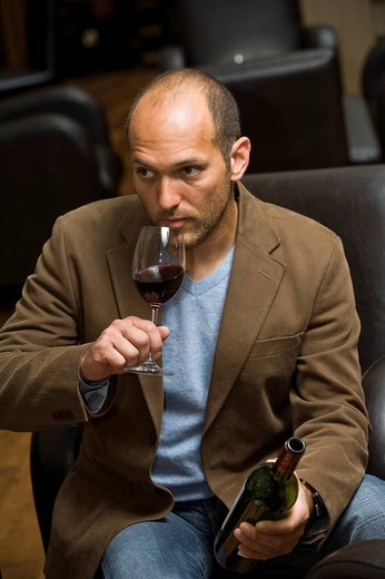 Stock Photo: 1848R-342566 Young man drinking wine