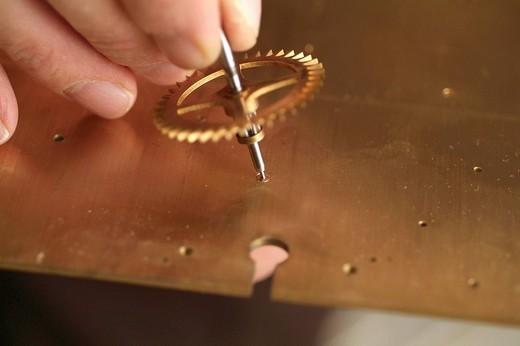 Clockmaker restore clock : Stock Photo
