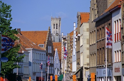 Narrow lane and tower Belfried in Brugge Belgium : Stock Photo