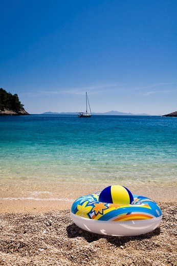 Bathing toys on the beach, Korcula island, Dubrovnik Neretva, Dalmatia, Croatia, Europe : Stock Photo