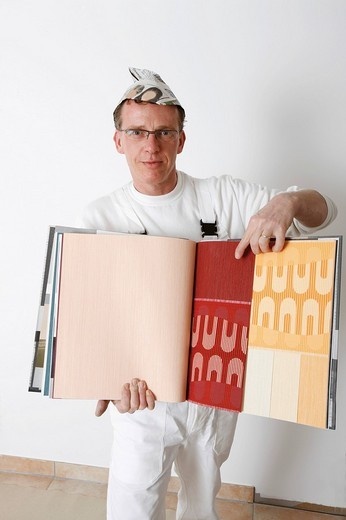 Painter with wallpaper samples : Stock Photo