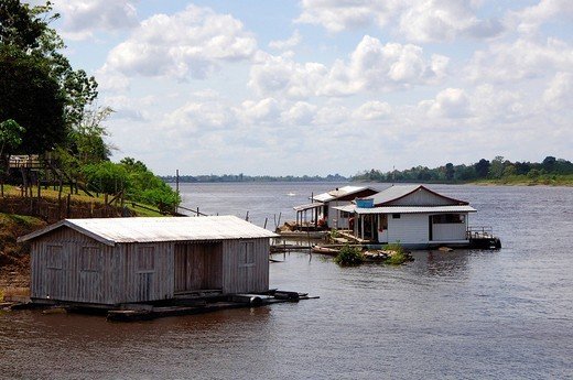 Stock Photo: 1848R-346637 Floating house boat on a tributary to the Amazon river Amazonia Brazil