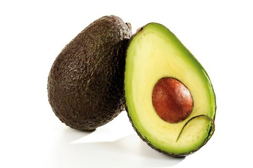Ripe avocado, whole and halved : Stock Photo