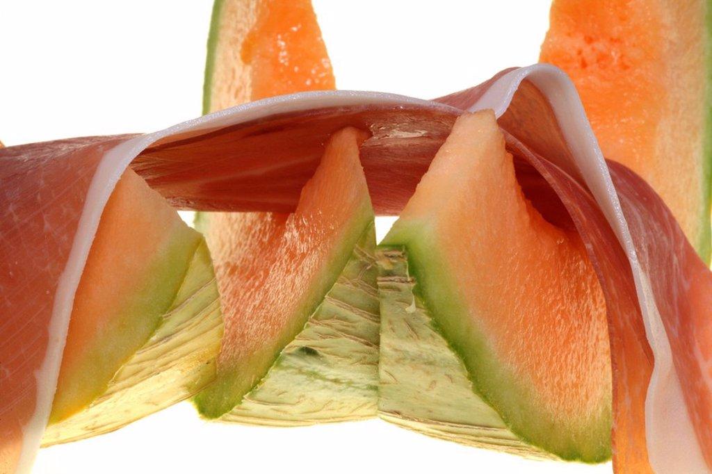 Stock Photo: 1848R-347767 Summer diet: Charentais melon and Parma ham