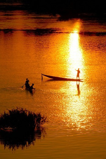 Stock Photo: 1848R-347987 Sunset fishermen in boats on the Mekong River Muang Khong Si Phan Don Laos