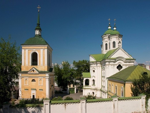 Ukraine Kiev district Podil Pokrovs´ka cerkva church of Marias protection 1766-1772 with belltower green roofs of the church blue sky 2004 : Stock Photo