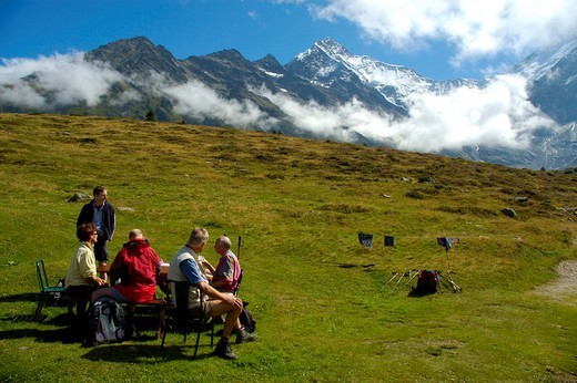 Hiking group rests on a meadow at Mont Truc Haute-Savoie France : Stock Photo