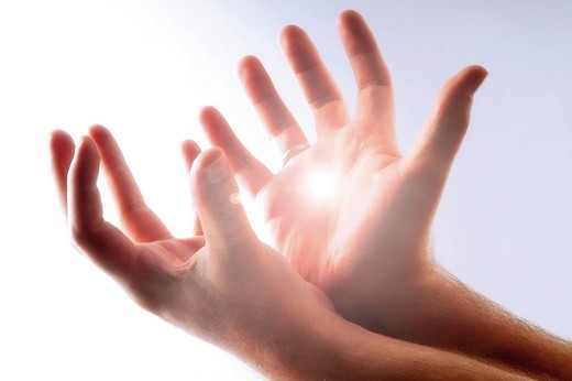 Stock Photo: 1848R-348623 Hands seeking help in gleaming light