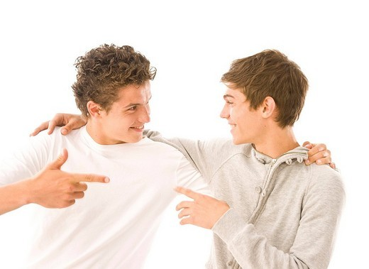 Stock Photo: 1848R-348863 Two guys having fun together