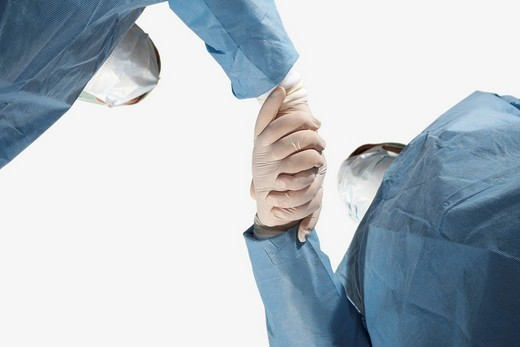Two doctors linking hands : Stock Photo