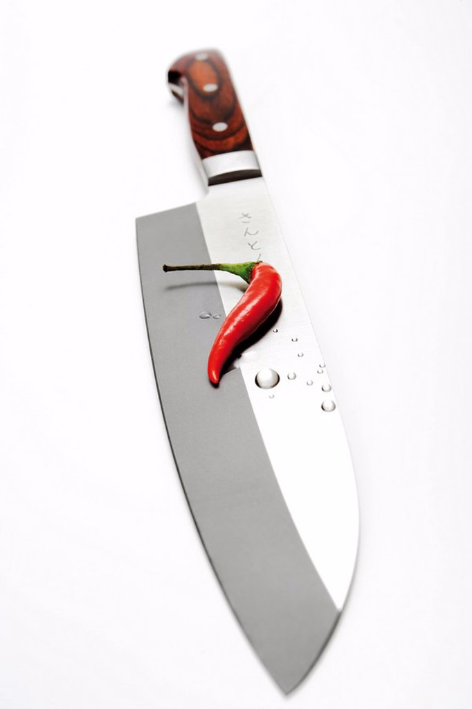 Stock Photo: 1848R-349414 Hot pepper on knife