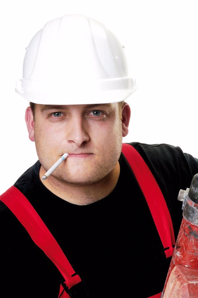 Construction worker wearing a white hardhat smoking a cigarette : Stock Photo