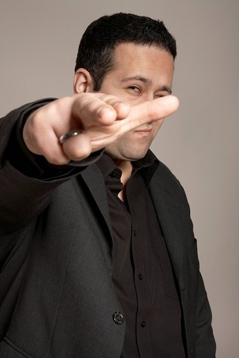 Stock Photo: 1848R-351540 Businessman pointing at you