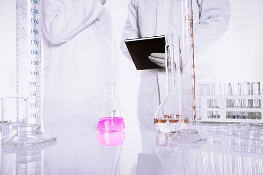 Stock Photo: 1848R-351585 Chemist conducting an experiment in a lab