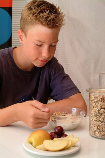 Boy eating muesli : Stock Photo