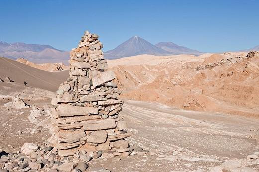 Stock Photo: 1848R-355540 Cairn and the Licancabur Volcano 5920 m or 19422 ft viewed from the Valle de la Muerte Death Valley or sometimes called Martian Valley, San Pedro de Atacama, Región de Antofagasta, Chile, South America