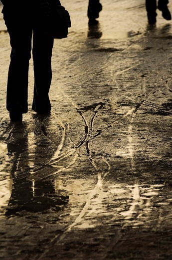 Puddles, skid marks and footprints after a rainshower : Stock Photo