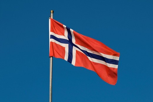 Stock Photo: 1848R-357259 Norwegian flag against a blue sky