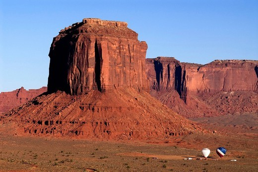Stock Photo: 1848R-357402 Starting hot air balloons below Merrick Butte and Sentinel Mesa, Monument Valley Navajo Tribal Park, Utah, USA
