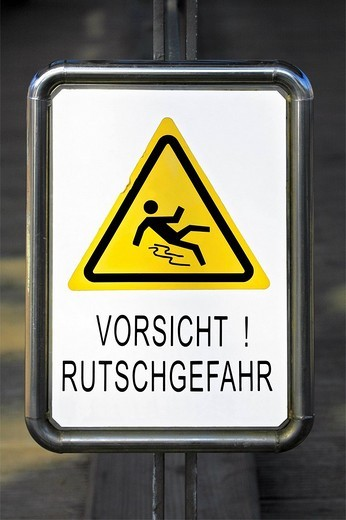 Sign, warning, Vorsicht Rutschgefahr, caution slippery : Stock Photo