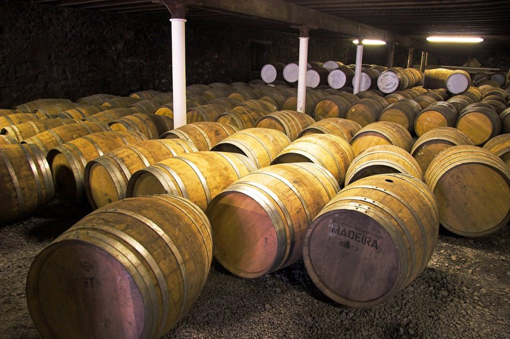 Stock Photo: 1848R-358930 Used casks laying in the cellar of a distillery, get recycled and filled again