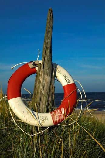 Stock Photo: 1848R-359334 Life belt, Sandhammaren beach, Ystad, Sweden
