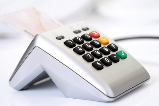 Stock Photo: 1848R-359808 Debit card bank client card in a card reader