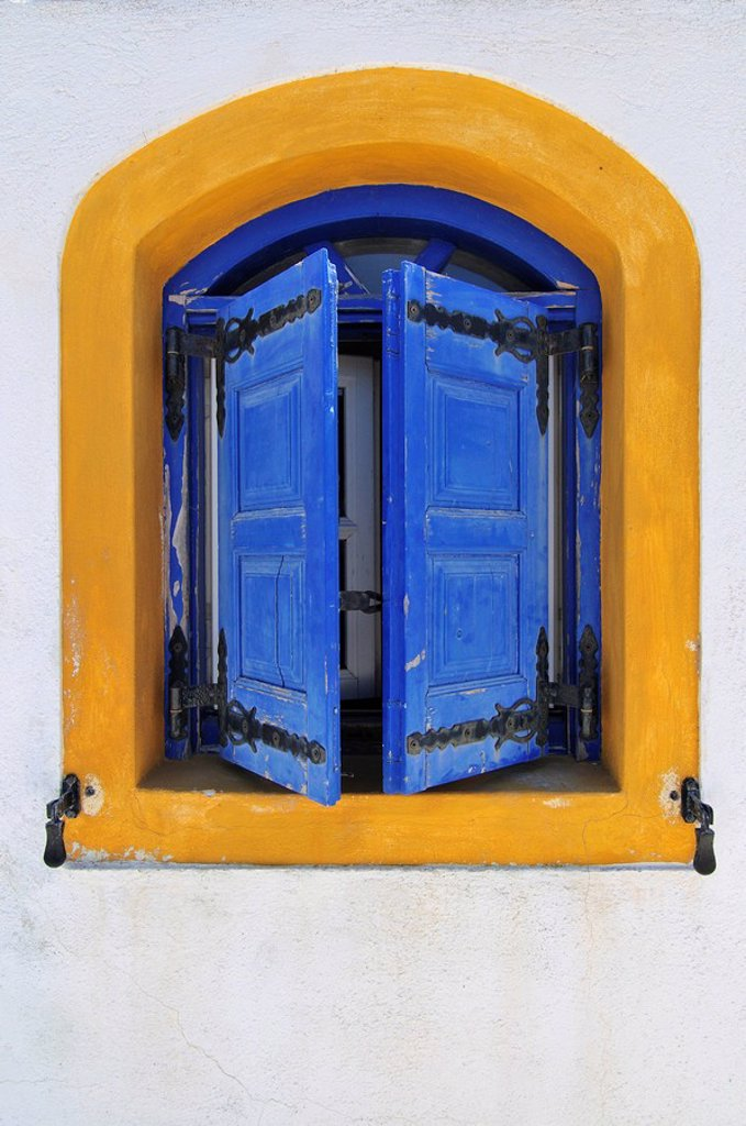 Yellow window frame with blue shutters, Santorini, Cyclades, Greece, Europe : Stock Photo
