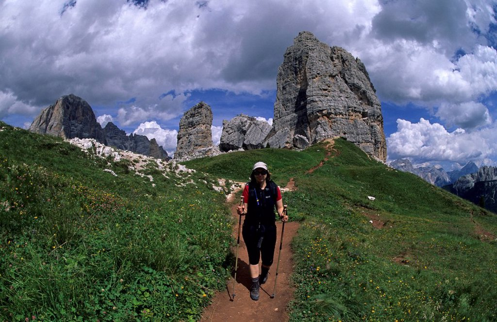 Female hiker in front of the Cinque Torri, Cortina d´Ampezzo, Ampezzo Dolomites, Italy, Europe : Stock Photo