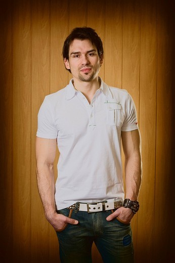 Man wearing a white shirt and jeans, partial portrait : Stock Photo