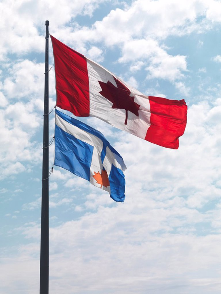 Stock Photo: 1848R-360353 Flags of Canada and Toronto in the wind