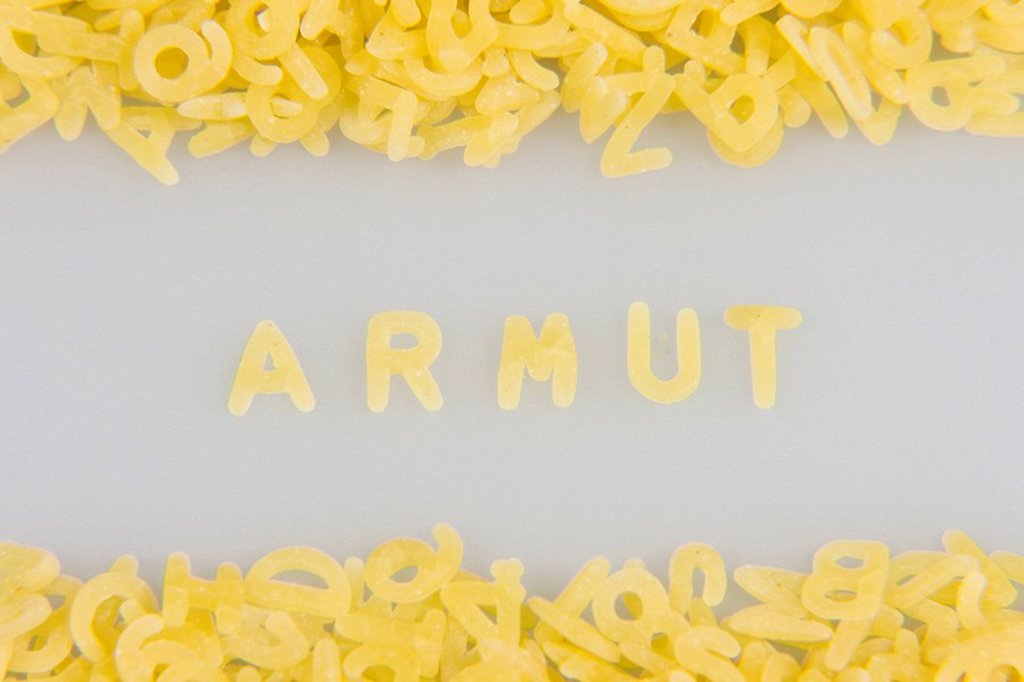 Armut Poverty written in noodle letters, pasta alphabet : Stock Photo