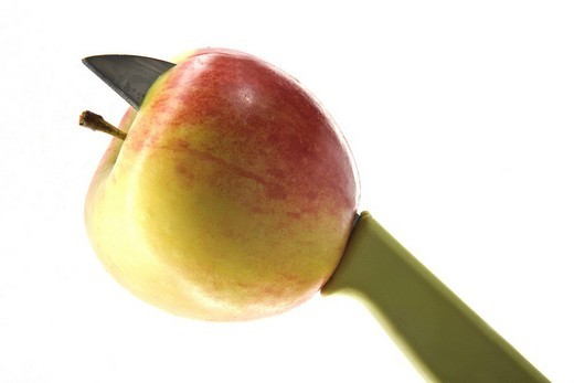 Apple impaled by a knife : Stock Photo