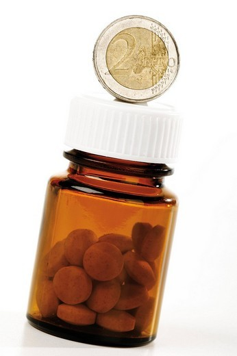 Stock Photo: 1848R-361931 Euro coin and pill bottle: symbol for rising medical costs
