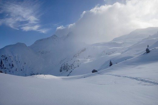 Stock Photo: 1848R-362958 Foehn clouds over recently snowed up untouched winter landscape in the Zillertal alps Tyrol Austria